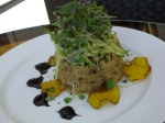 Red Beet Quinoa with Zucchini Noodles, Golden Raisins and Toasted Almonds, Avocado Basil oil and Yellow Beet Chips